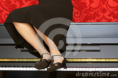 Woman sitting on a piano