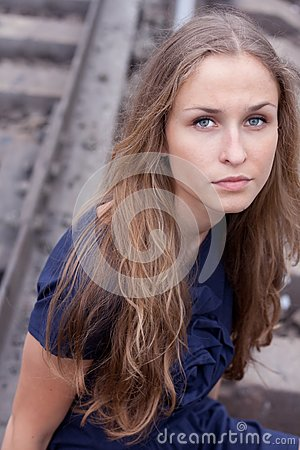 Woman sitting on rails