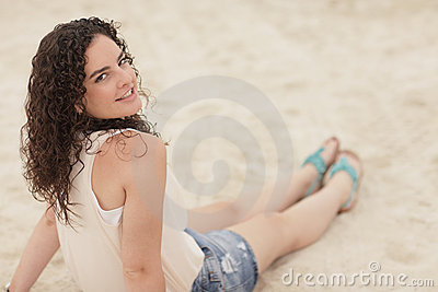 Woman sitting on the sand