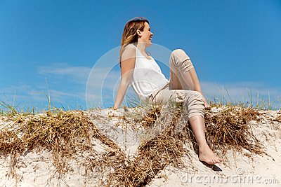 Woman Sitting on Sand Dunes