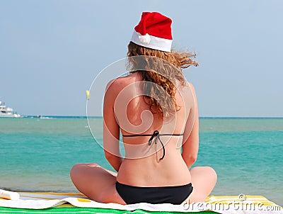 Woman is sitting in santa hat