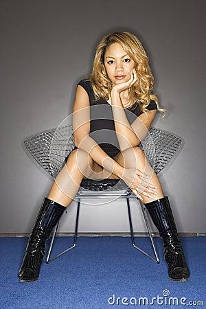 Woman Sitting Seductively Royalty Free Stock Image
