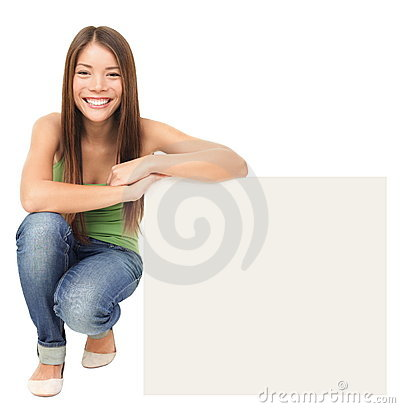 Free Woman Sitting Showing Billboard Sign Stock Photography - 18833352