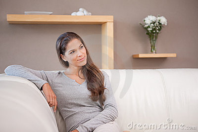 Woman sitting on the sofa