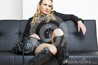 Woman sitting on sofa