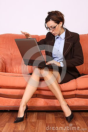 Woman sitting on the sofa working on lap top