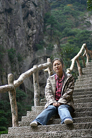 Woman sitting on steep steps