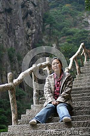 Woman sitting on steep steps
