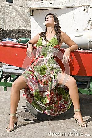 Woman sitting under the sun
