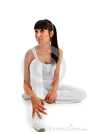 Woman sitting wearing fitness clothing.