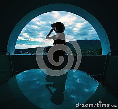 Woman sitting in a window
