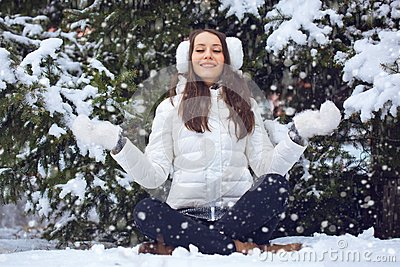 Woman sitting  in winter park