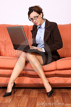 Woman sitting working on lap top computer