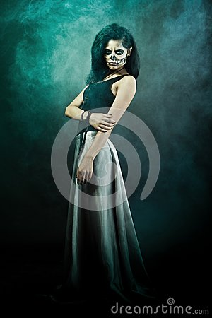Woman with skull face. Halloween face art