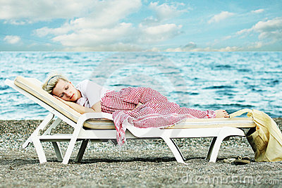 Woman sleep on beach
