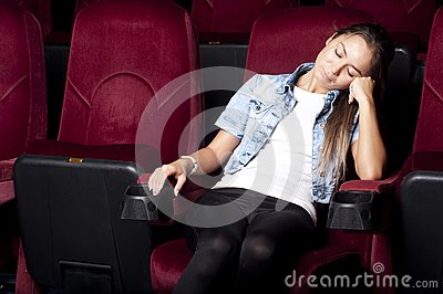 Woman sleep in the cinema