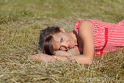 Woman sleep on green grass