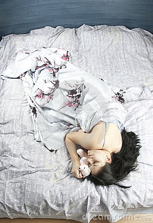 Young woman in bed sleeping and dreaming