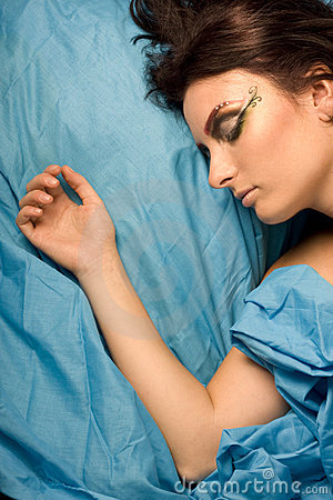 Woman sleeping in blue bedclothes