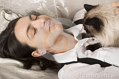 Woman sleeping with cat Stock Photo