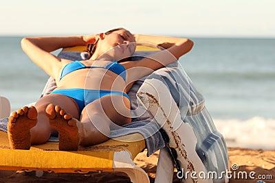 Woman sleeping on the chair