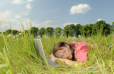 Woman sleeping on a laptop