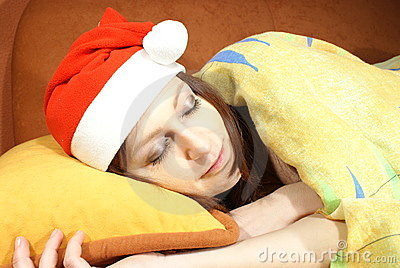 Woman sleeping with Santa hat