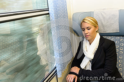 Woman sleeping in train compartment tired resting