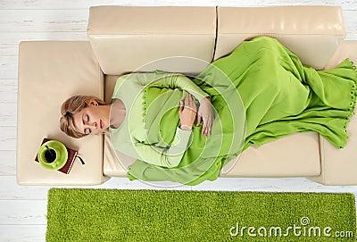 Woman sleeping under blanket