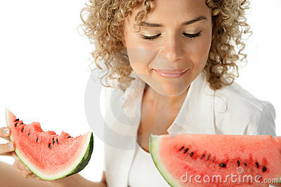 Woman with slices of watermelon