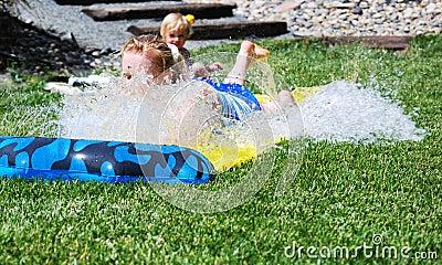 Woman sliding in water
