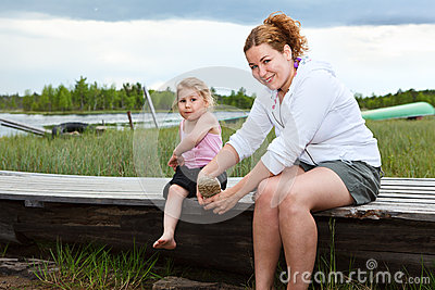 Woman and small kid near a river