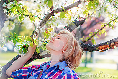 Woman smell flower from tree