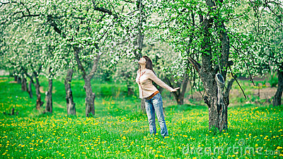 Woman smelling apple flowers