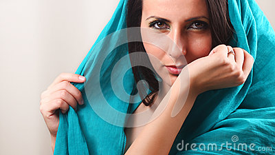 Woman smelling arm wrist