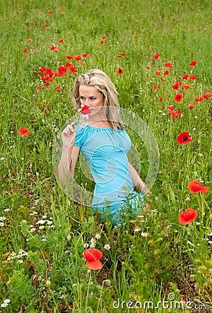 Woman smelling a bouquet