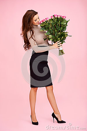Woman smelling a bunch of roses