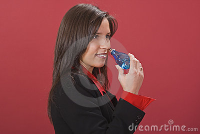 Woman smelling perfumme