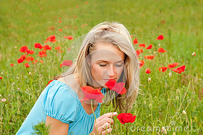 Woman smelling a poppy