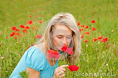 Woman smelling a poppy