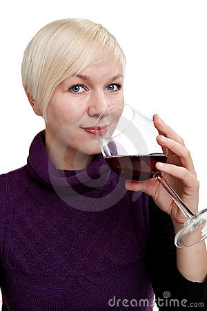 Woman smells at a glass of red wine