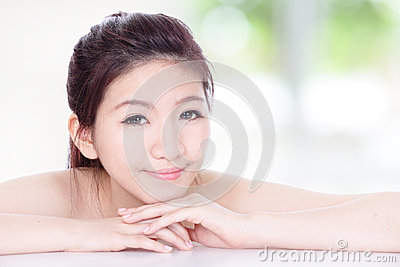 Woman smile face with nature green background