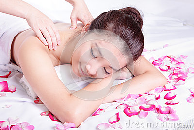 Woman smile getting spa treatment with rose