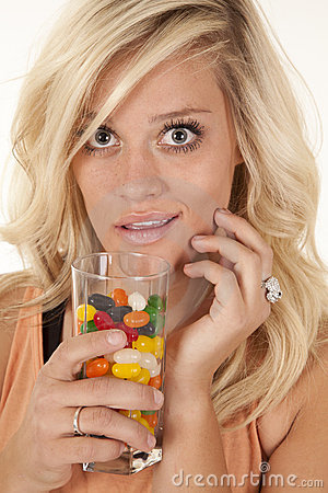 Woman smile glass of candy