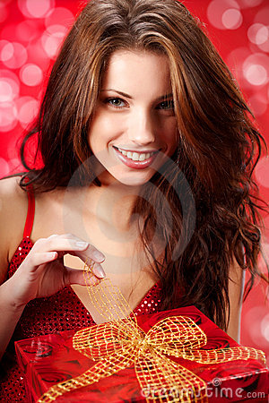 Woman smiles and holding a magic gift