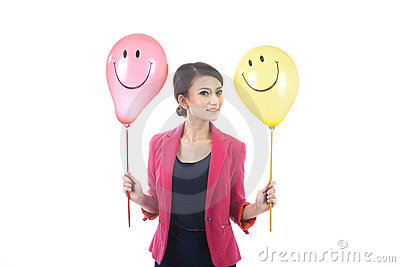 Woman with smiley face balloon