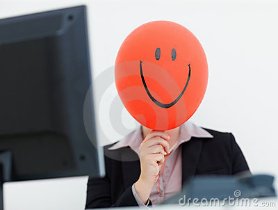 Woman with a smiley face balloon at work
