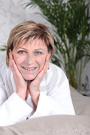Woman smiling in bathrobe