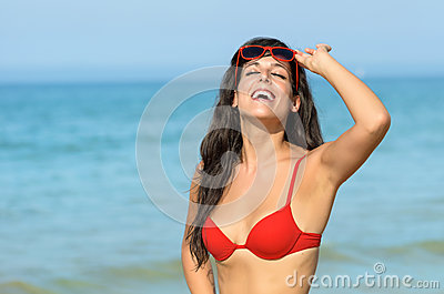 Woman smiling on beach vacation