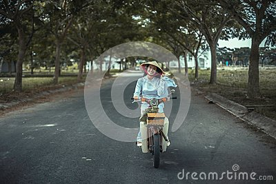 Woman Smiling While Biking On Road Near Trees During Daytime Free Public Domain Cc0 Image